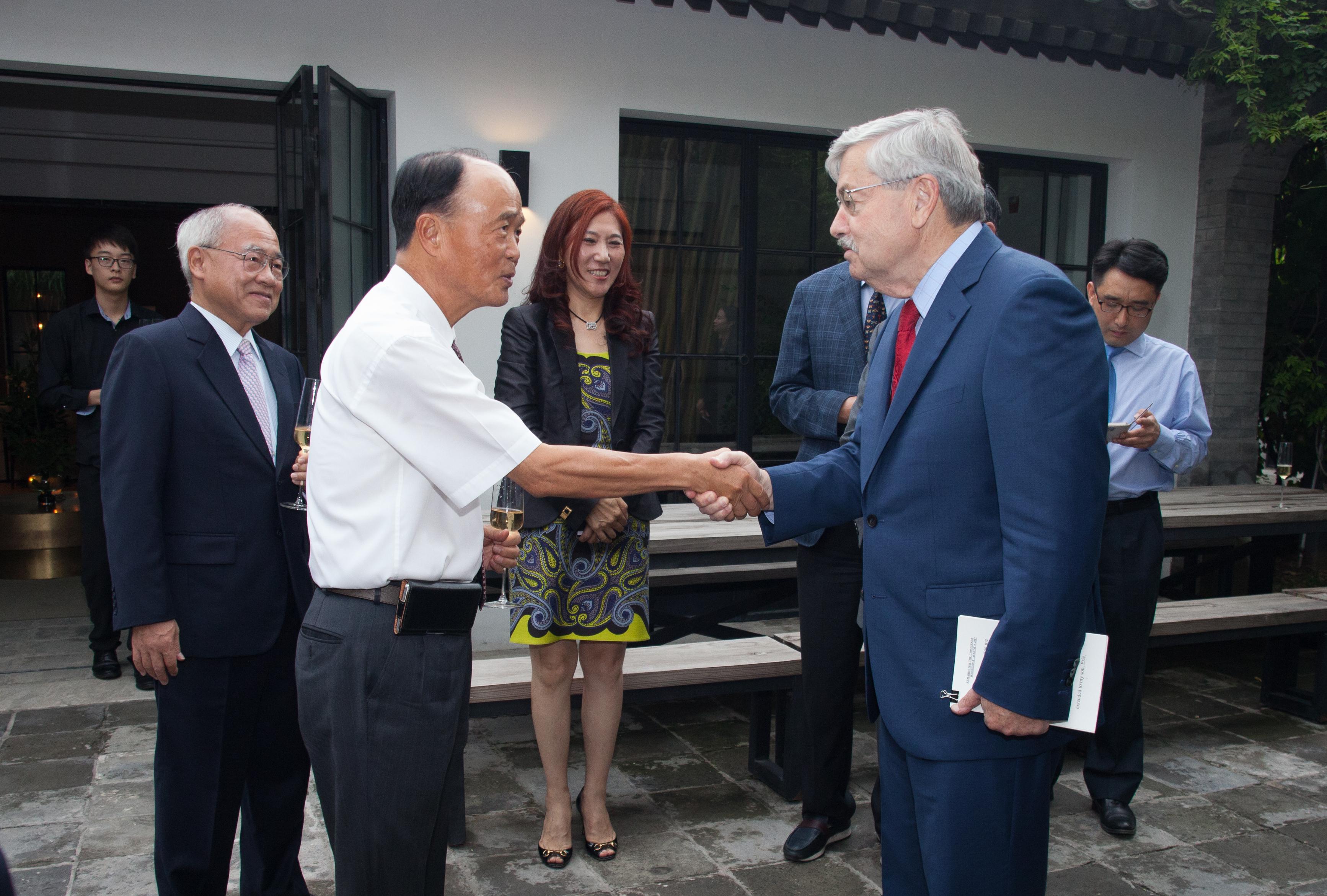 Carter Tseng and Ambassador Branstad shaking hands